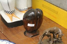 Carved Coco de Mer, on a chamfered wooden base, 16.5cm high