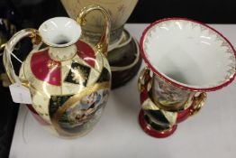 Two porcelain vases, the cream, green and puce ground with cartouches depicting a transferred