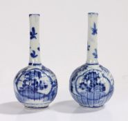 Pair of blue and white spill vases, the slender necks above gadrooned bulbous bodies, with foliate