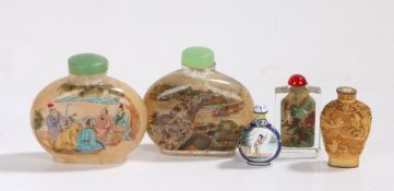 Five Chinese snuff bottles, to include two with figural, landscape and script decoration,