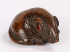 Japanese Edo period netsuke, the wood netsuke carved as a rat curled up upon it's tail and with
