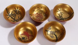 Set of five Japanese lacquered bowls, with bamboo, goldfish and blossom decoration to the