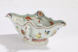 Chinese porcelain famille rose sauceboat, with foliate decoration and loop side handles
