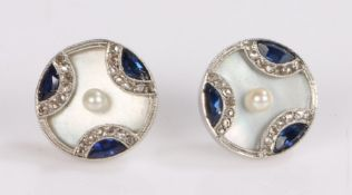 Pair of pearl diamond and sapphire set ear studs, disc form with a central pearl on mother of pearl,