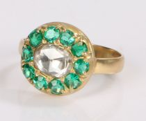 Emerald and diamond set ring, the central rose cut diamond with emerald surround, ring size M