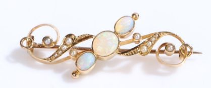 Opal and pearl set brooch, with three opals to the central pearl set scrolls, 47mm long