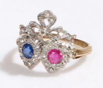 18 carat gold sapphire, diamond and ruby set heart ring, the head with two hearts under a ribbon set