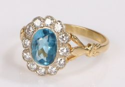 Aquamarine and diamond set ring, the central aquamarine at 1.30 carats with a diamond surround, ring