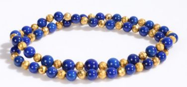 Lapis lazuli necklace, with beads and gilt beads graduated to the necklace. 72cm long