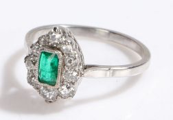 Emerald and diamond set ring, the central emerald at 0.90 carat with a diamond surround estimate