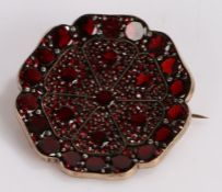 Garnet set brooch, in a wide flower head design, 36mm diameter