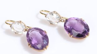 Pair of amethyst earrings, with an oval amethyst and clear stone above, 28mm long
