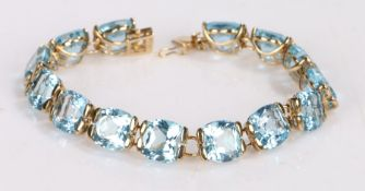 9 carat gold blue zircon set bracelet, with a row of zircons to the bracelet with clasp end, 18cm