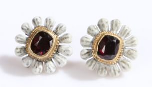 Pair of garnet and enamel earrings, the studs in the form of flower heads with a central garnet,