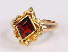 Garnet set ring, the diamond cut garnet with a scroll surround, ring size K