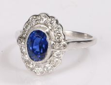 Ceylon sapphire and diamond set ring, the certificated Ceylon oval cut sapphire at 1.97 carats and