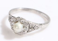 Pearl and diamond set ring, with a central pearl and diamond surround on white metal, ring size O