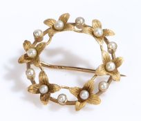 Pearl set brooch, within a leaf round design, 24mm diameter