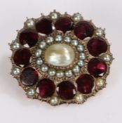 Victorian pearl and garnet brooch, with a central pearl and garnet surround, 30mm diameter