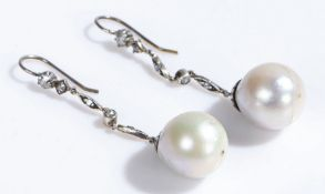 Pair of diamond and pearl set earrings, with diamonds set to the stem above the drop pearl, 50mm