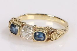 Sapphire and diamond set ring, the central diamond at 0.23 carat flanked by sapphires at 0.67