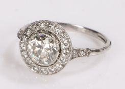 Diamond set ring, the central round cut diamond at an estimated 1,32 carat and a diamond surround on