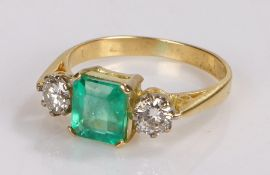 Emerald and diamond set ring, with a central emerald at 1.48 carat and a diamond to either side at