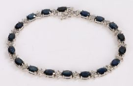 Sapphire and diamond set bracelet, with a row of sapphires interspersed by diamonds, an estimated