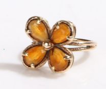 9 carat gold ring, with four orange stones set in a flower head formation, ring size J1/2, 4g