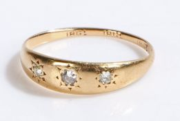 18 carat gold ring set with three diamonds, ring size O1/2, 1.8g