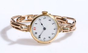 18 carat gold ladies wristwatch, the white dial with Arabic markers, manual wound, the case 25mm