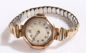 9 carat gold ladies wristwatch, the white engine turned dial with Arabic markers, manual wound,