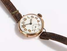 9 carat gold gentlemans wristwatch, the white dial with Arabic numerals and subsidiary seconds dial,