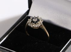9 carat gold ring, set with blue and clear paste, ring size N, 2g