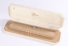 Lotus double strand graduated pearl necklace, with paste set clasp, in original box