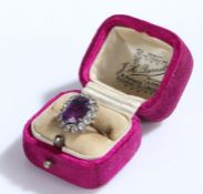 Gold coloured metal ring, set with purple and clear paste, ring size N, 3.1g