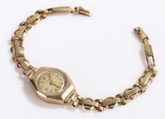Hirgo 9 carat hold ladies wristwatch, the signed cream dial with Arabic and triangular markers,