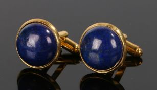 Pair of lapis lazuli cufflinks, with cabochon cut lapis lazuli set to gilt metal