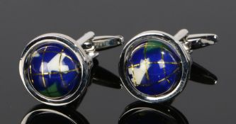 Pair of cufflinks, with a pair of swivel globes to the heads