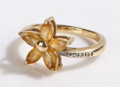 9 carat gold ring, with five oval yellow stones set in a star formation, ring size L1/2, 3.2g