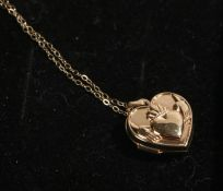 9 carat gold locket, of heart form with depiction of two hands holding a heart, on a necklace, 1.6g