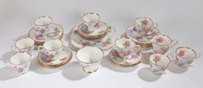 Royal Stafford Carousel pattern part tea service, consisting of nine teacups, twelve saucers, twelve