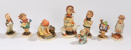 Collection of eight Goebel Hummel figures, to include Doctor, Big House Cleaning, Apple Tree Boy,