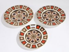 Three Royal Crown Derby Imari pattern plates, two 26.5cm diameter, one 22cm diameter (3)
