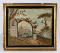 George III silk work picture, depicting primitive figures under an arch by a river, 42cm x 36cm