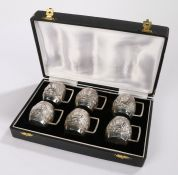 Set of six Indian silver tot cups, the barrel form bodies with embossed figural, elephant and