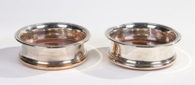 Pair of 19th Century silver plate on copper wine bottle coasters, each with wooden bases, 15cm