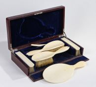 Edwardian ivory dressing table set, with brushes and mirror housed within a fitted leather box, 37.