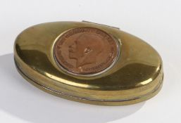 Miners brass twist tobacco box, of oval form, the hinged lid inset with a George V penny, 7.5cm