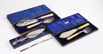 Two pairs of silver plated fish servers, each in fitted cases, together with a silver plated